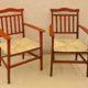 Art.MMA.4 - Coppia di poltrone da caminetto, in legno tinto rosso e seduta impagliata (impagliatura appena rifatta). Toscana fine '800. Misure: 184 x 68 x h 108 cm.