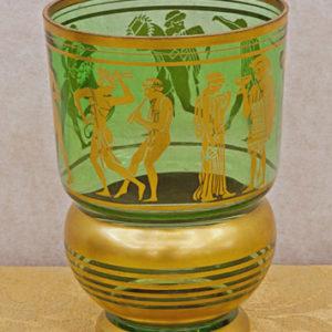 Art.VEC.7 - Vaso art decò in vetro verde, decori e figure color oro. Francia 1920 circa. Presenta piccola sbreccatura sul bordo esterno. Misure: diametro 14 x h 22 cm.